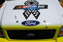 A truck is painted with a NASCAR Day logo