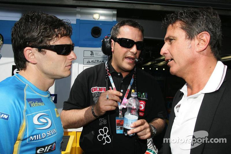 Giancarlo Fisichella parle avec son manager Enriquo Zanarini