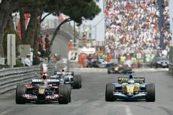 Vitantonio Liuzzi in front of Giancarlo Fisichella and Mark Webber