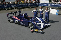 Bill Binnie, Allen Timpany, and Yojiro Terada pose with the Binnie Motorsports Lola 05/42 Zytek