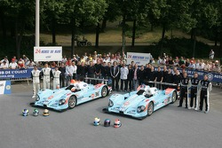 Claude-Yves Gosselin, Karim Ojjeh, Adam Sharpe, Didier André, Yann Clairay, Didier André, and the Paul Belmondo Racing Team pose with the Paul Belmondo Racing Courage C65 Ford