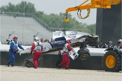 Car of Nick Heidfeld is taken away after the crash at turn 1
