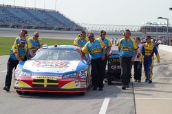 Bobby Labonte accompanies his crew as they push the #43 Dodge into the qualifying line