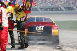 Lug nuts fly as Dave Blaney pulls out after his pit stop