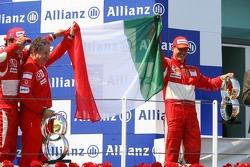 Podium: race winner Michael Schumacher celebrates with Felipe Massa and Jean Todt