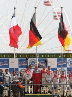 LMP1 podium: class and overall winner Marco Werner, Frank Biela and Emmanuele Pirro, with second place Éric Hélary, Franck Montagny and Sébastien Loeb, and third place Allan McNish, Rinaldo Capello and Tom Kristensen