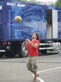 Giorgio Pantano plays football in the paddock