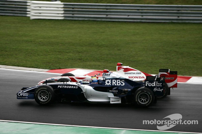 Mark Webber y Takuma Sato