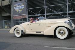 A vintage car cruises