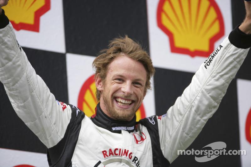 Podium: race winner Jenson Button celebrates