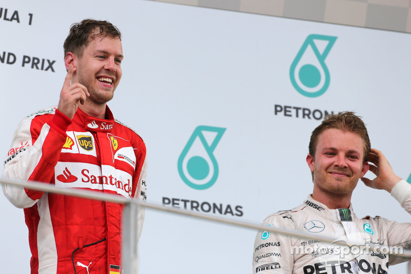 Sebastian Vettel, Scuderia Ferrari, und Nico Rosberg, Mercedes AMG F1 Team