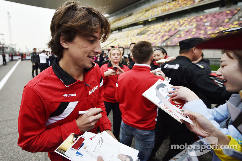 Roberto Merhi Manor Marussia F1 Team signs autographs for the fans