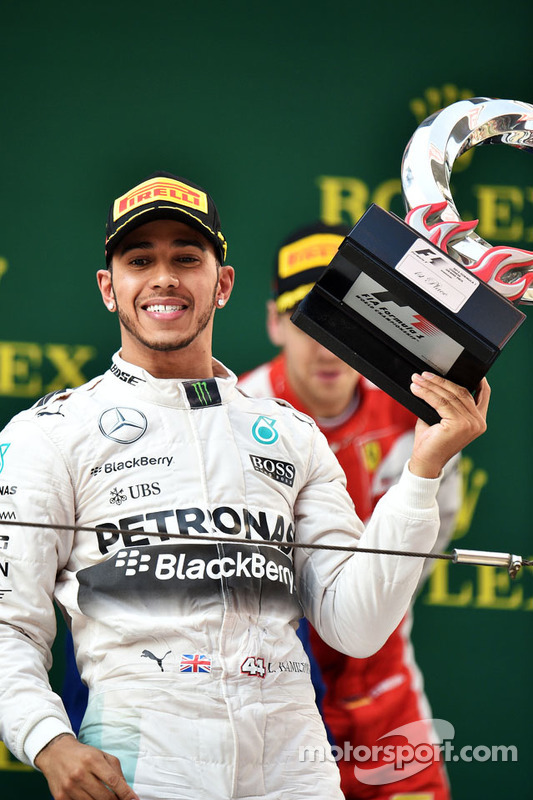 Race winner Lewis Hamilton Mercedes AMG F1 celebrates on the podium