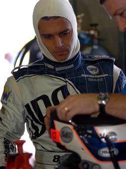 Max Wilson gets running repairs on his helmet