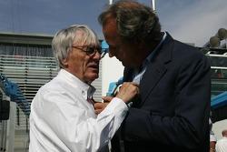 Bernie Ecclestone and Angelo Codignoni, Eurosport president and CEO