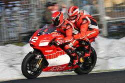 Motorcycle fanatic Lachlan Murdoch rides with Randy Mamola on the Ducati Marlboro Team Desmosedici two-seater