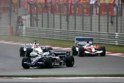 Nico Rosberg leads Robert Kubica and Jarno Trulli