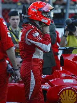Michael Schumacher climbs aboard his Scuderia Ferrari 248 F1 car for the last time