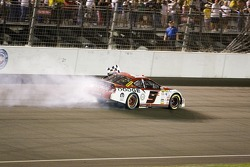 Kasey with the checkered flag