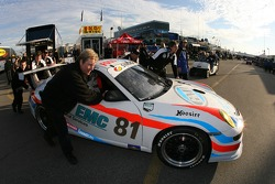 Synergy Racing crew members push the #81 Porsche GT3 Cup to the post-qualifying technical inspection