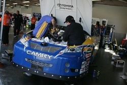 NAPA Toyota crew members prepare the backup car of Michael Waltrip