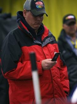 A Dupont Chevy crew member makes phone calls