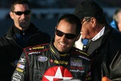 Juan Pablo Montoya shares a laugh with a NASCAR official