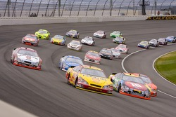 Kevin Harvick leads a group of cars