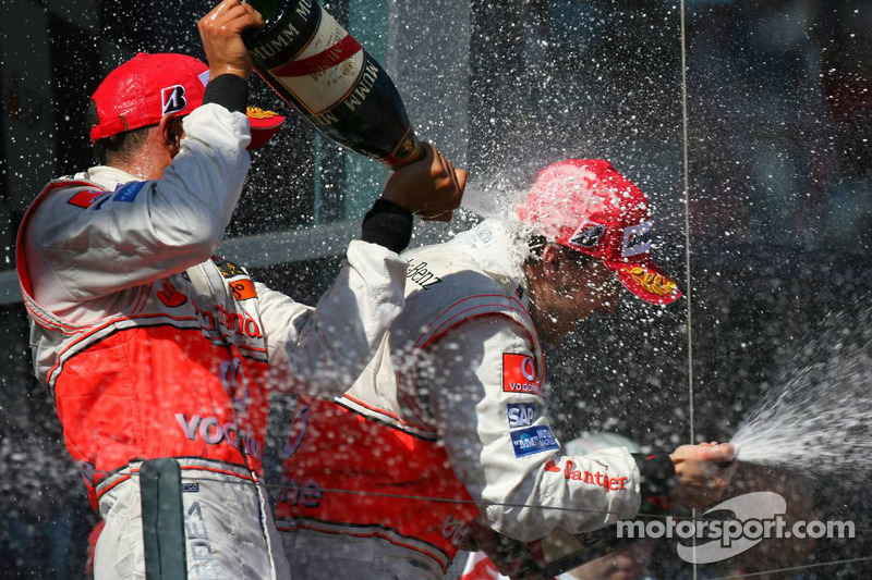 Podium: champagne for Fernando Alonso and Lewis Hamilton