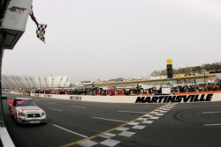 Mike Skinner takes the checkered flag