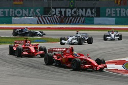Felipe Massa, Scuderia Ferrari, F2007 leads Kimi Raikkonen, Scuderia Ferrari, F2007