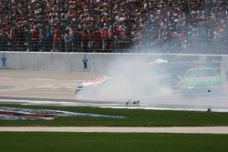 Regan Smith and J.J. Yeley collide on the front straight