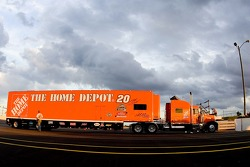 The Home Depot Chevy team hauler enters the track