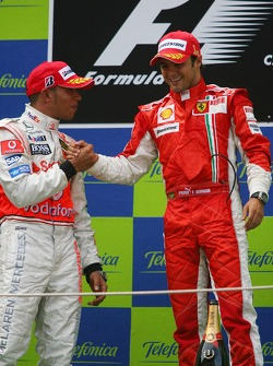 Podium: race winner Felipe Massa celebrates with Lewis Hamilton
