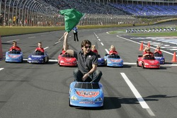 Jeff Gordon waves the green flag to start the Fisher-Price Power Wheels All-Star Challenge featuring NASCAR Power Wheels