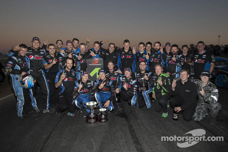 Race winner Mark Winterbottom and Chaz Mostert celebrate with Prodrive Racing Australia Ford team