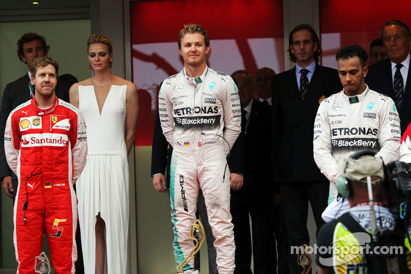 Podium: second place Sebastian Vettel, Ferrari and winner Nico Rosberg and third place Lewis Hamilto