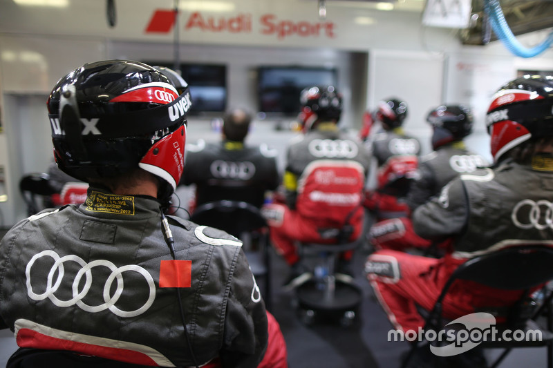 Audi Sport mechanics watch the race action