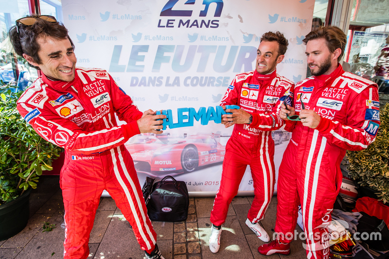 Rebellion Racing: Nicolas Prost and Mathias Beche pull the #LEMANS sign while Nick Heidfeld looks on