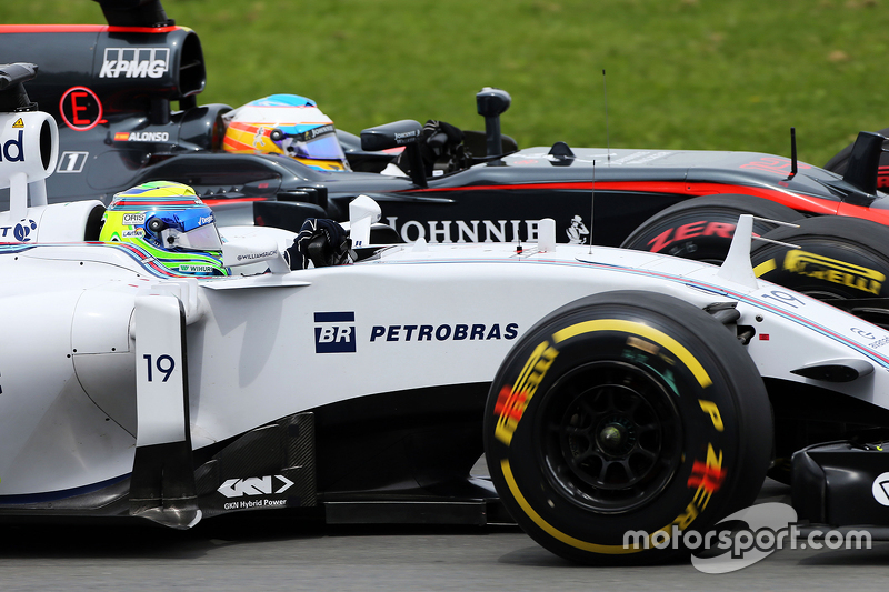 Felipe Massa, Williams FW37 and Fernando Alonso, McLaren MP4-30 battle for position