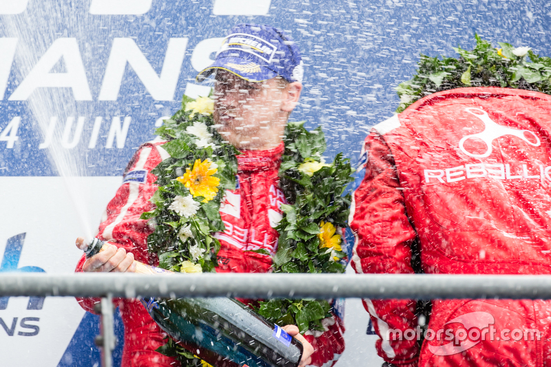 LMP1 privateer podium: Rebellion Racing drivers celebrate with champagne