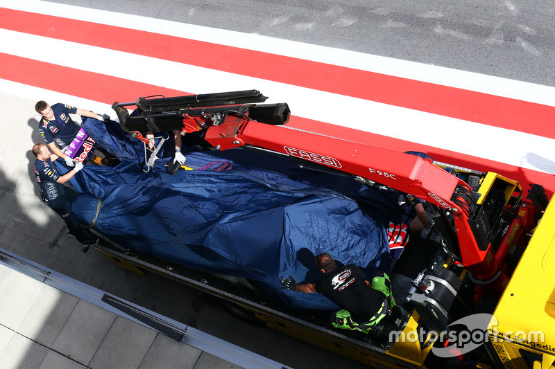 Red Bull Racing RB11 of Daniel Ricciardo, Red Bull Racing is recovered back to pits on back of a truck