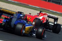 Kimi Raikkonen, Ferrari SF15-T leads Raffaele Marciello, Sauber C34 Test And Reserve Driver