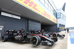 The McLaren MP4-30s of Fernando Alonso, McLaren and Jenson Button, McLaren