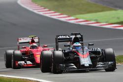 Fernando Alonso, McLaren MP4-30 leads Kimi Raikkonen, Ferrari SF15-T