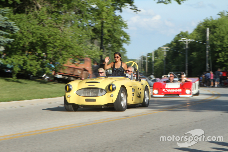 Race cars parade into Elkhart Lake for the concours  1959 Austin Healy 101