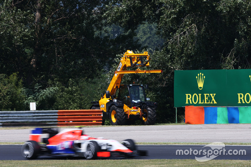 Fabio Leimer, Manor F1 Team Reserve Driver passes a circuit recovery vehicle