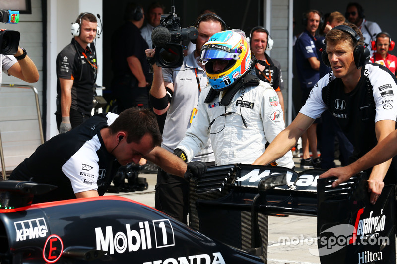 McLaren MP4-30 of Fernando Alonso, McLaren is pushed into pits during qualifying