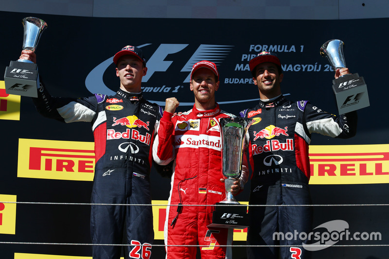 Podium: second place Daniil Kvyat, Red Bull Racing and Winner Sebastian Vettel, Ferrari and third place Daniel Ricciardo, Red Bull Racing