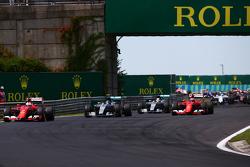 Sebastian Vettel, Ferrari SF15-T leads at the start of the race